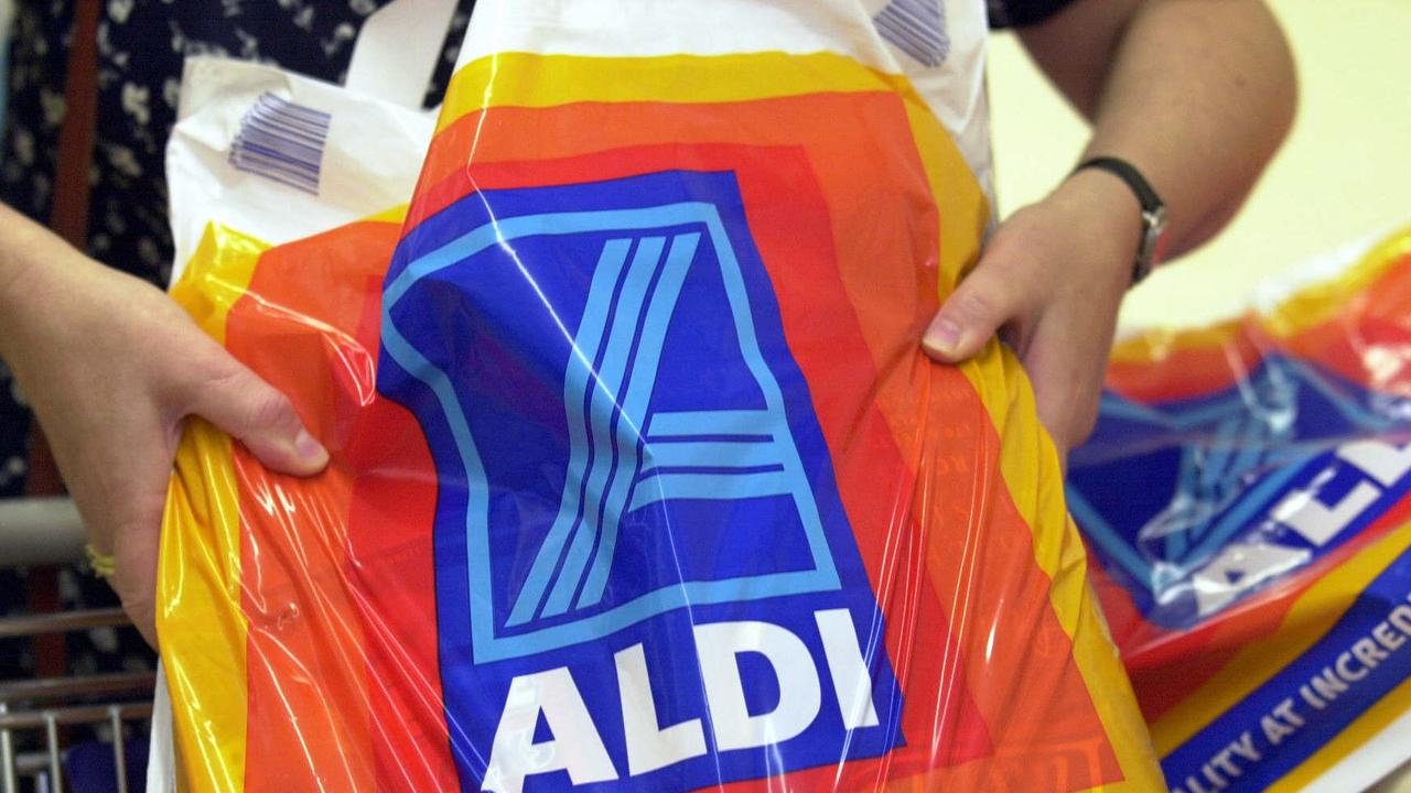 Jan 25, 2001: Shoppers at new discount supermarket chain Aldi at Bankstown, PicKelly/Rohan. NSW / Shopping bags retail stores logo logos