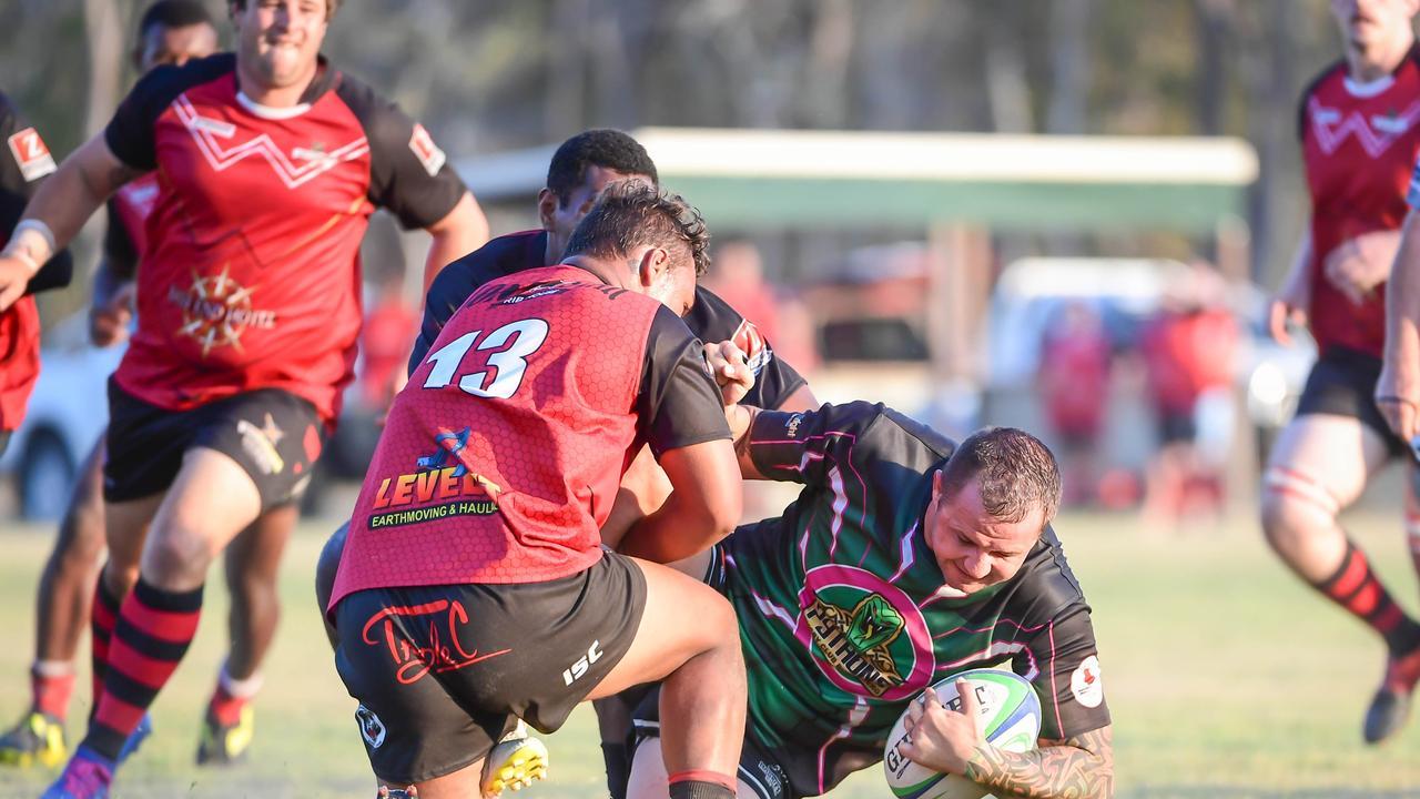 Pythons Danny Moran gets tackled.