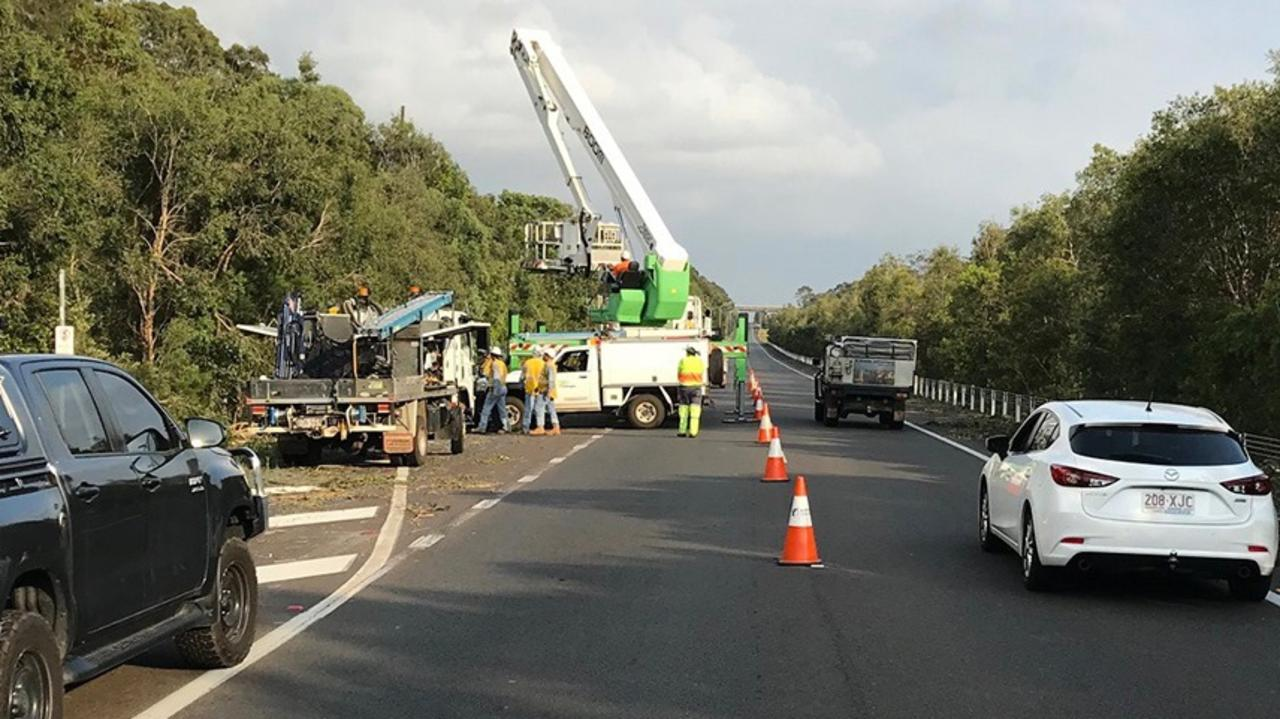 Traffic is delayed on the Sunshine Motorway this morning while works continue on a power pole that was damaged in yesterday's storm. Photo: Energex
