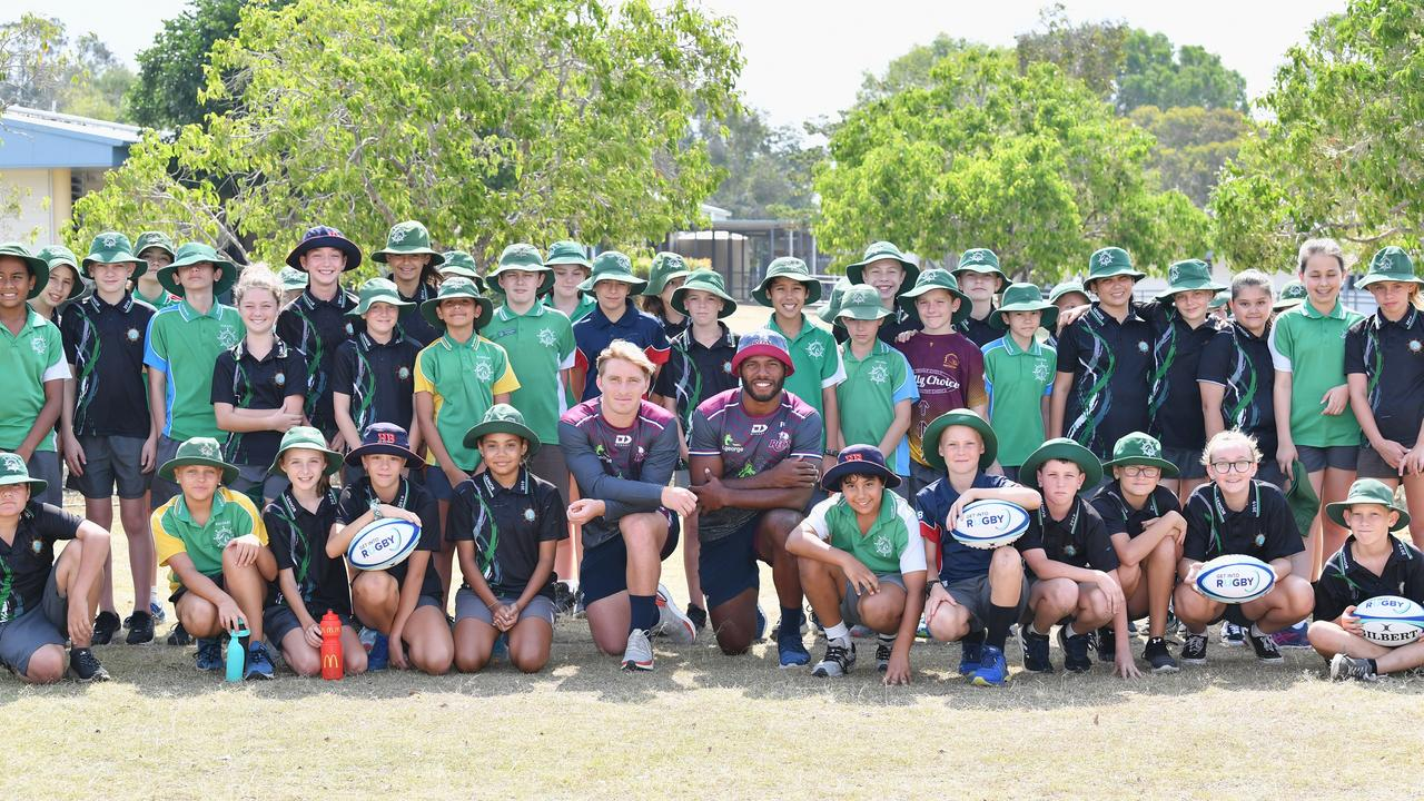 Reds players Tate McDermott and Filipo Daugunu with students from Sandy Strait State School.
