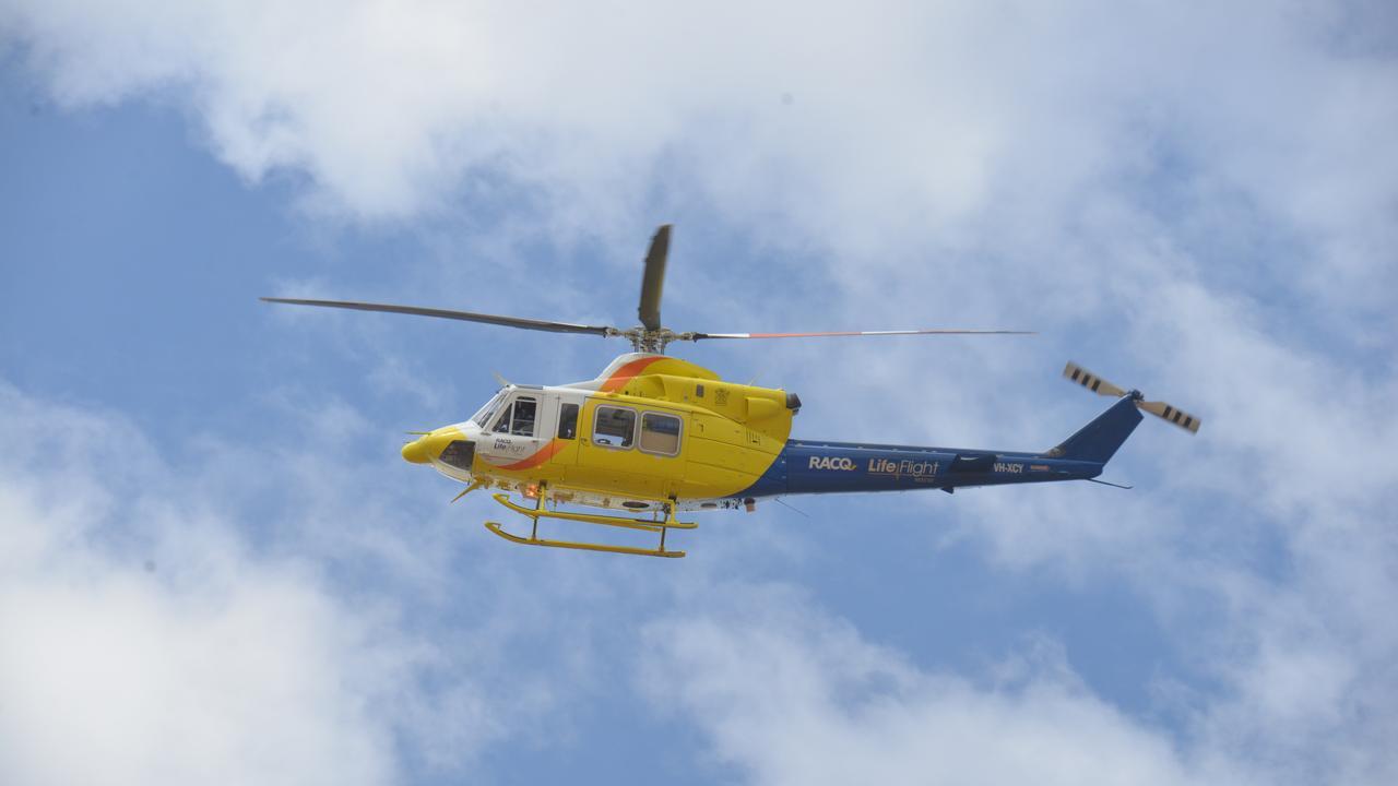 A LifeFlight helicopter buzzes overhead.
