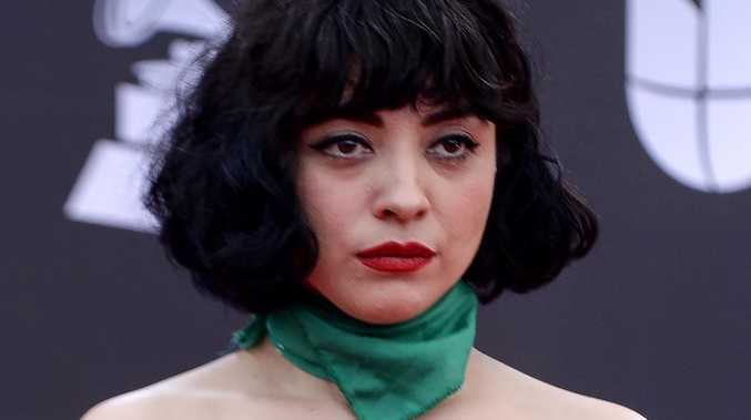 Singer goes topless on red carpet