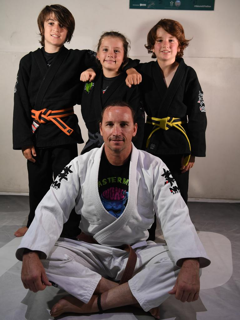 SQUAD: Noke Martial Arts students Thoran Schellhammer, 12, Harley Bennett , 8, and Tyson Schellhammer , 9, with their coach Nelson Noke.