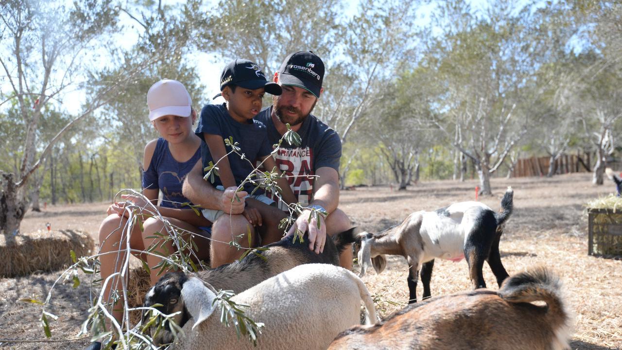 Ella and Craig Marshall with Mitchell Malcolm at Mitin Grove Goat Yoga