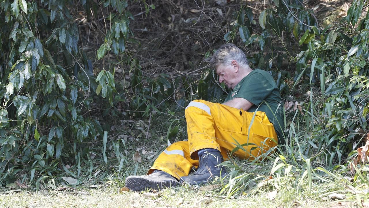 A firefighter takes a well-earned break by the roadside at Noosa Banks during the blaze that forced the evacuation of Tewantin. Picture: Peter Wallis