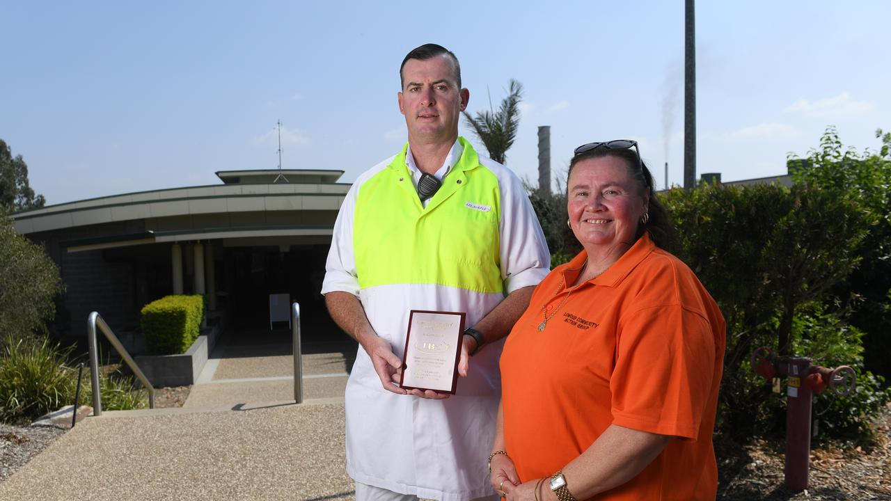 JBS plant manager Lee Shepley with Lowood Community Action Group donation co-ordinator Melissa Duckett.