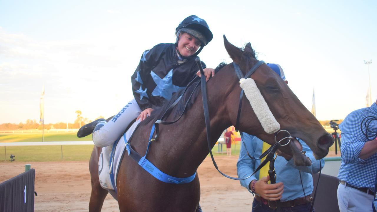 Brooke Richardson dismounts Atouchmore after winning the Roma Cup.