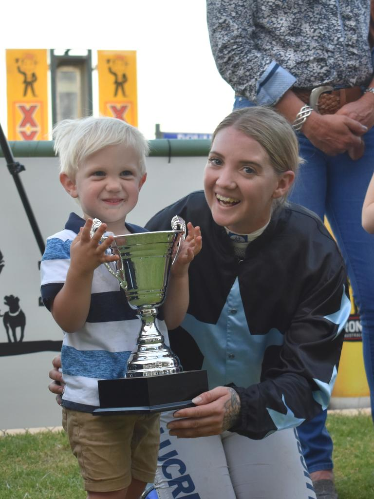 Brooke Richardson celebrates the Roma Cup win with her three-year-old son.