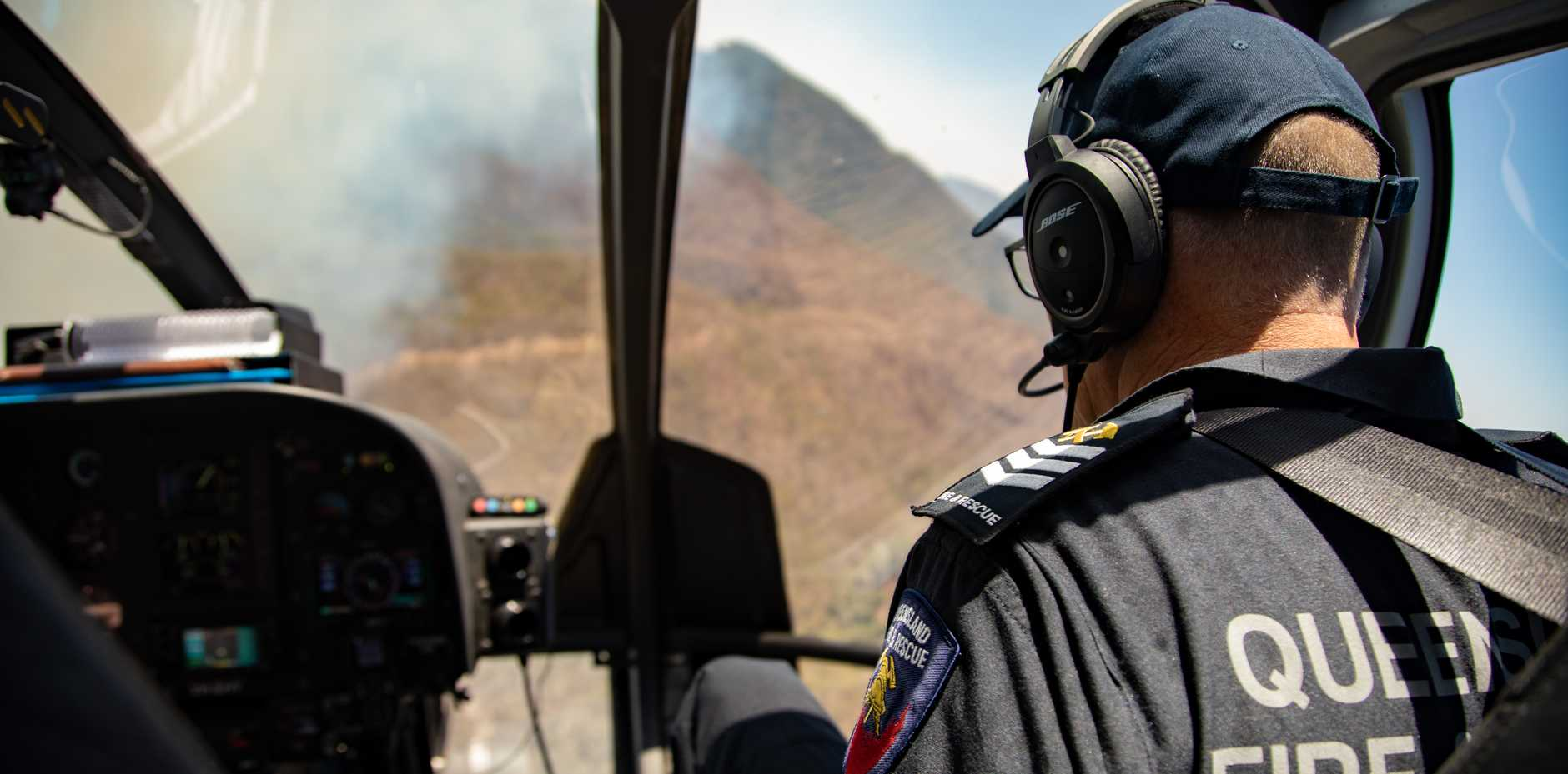 LEAVE NOW: Firefighters battle the blaze from the skies.
