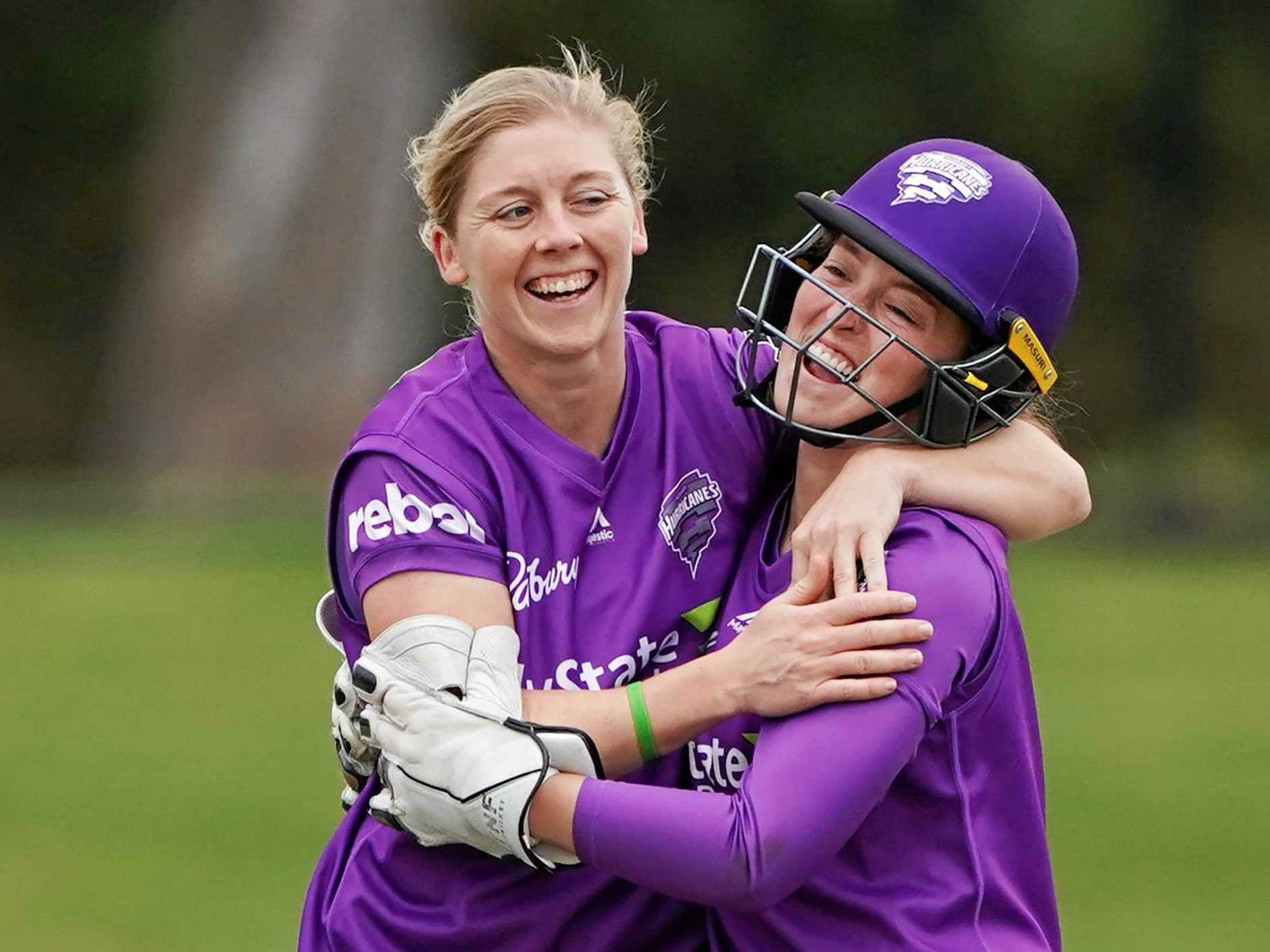 The Hurricanes' Heather Knight celebrates a wicket with Emily Smith at the Junction Oval, Melbourne on Sunday, October 20.  Picture: Michael Dodge/AAP