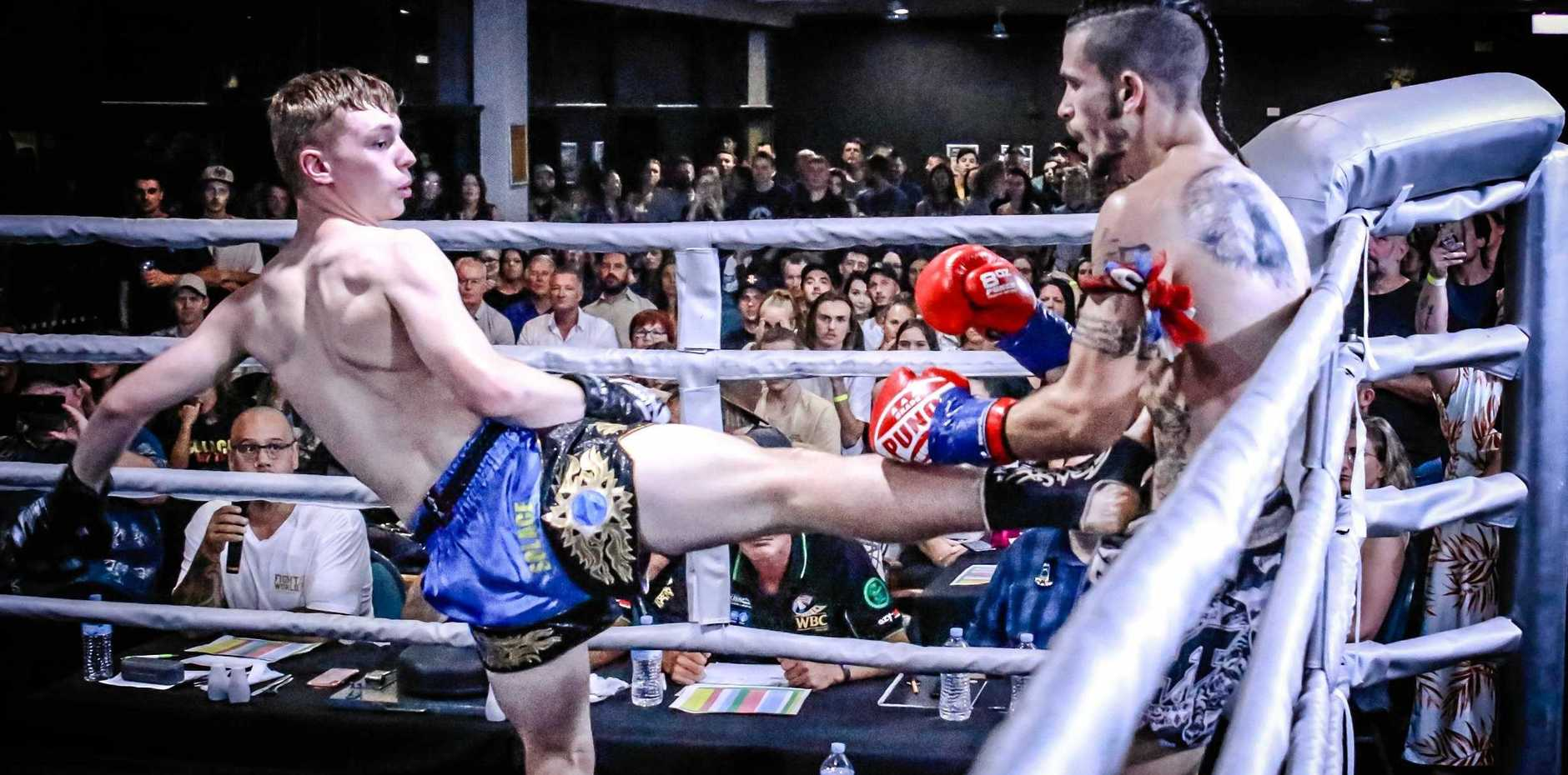 KICKING GOALS: Solace Muay Thai fighter John Slade (left) during a recent fight at Kirra Sports Club on the Gold Coast.