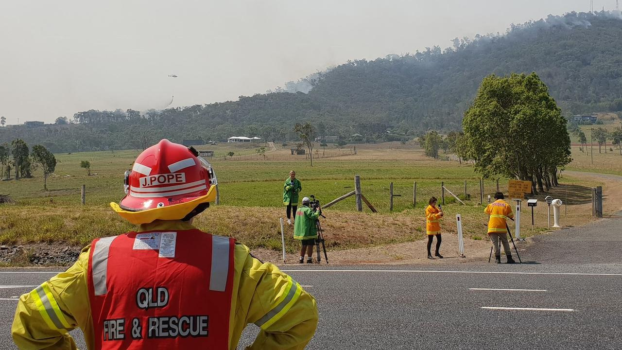 CLOSE WATCH: Firefighter watches helicopters waterbombing on Mount Barmaryee.