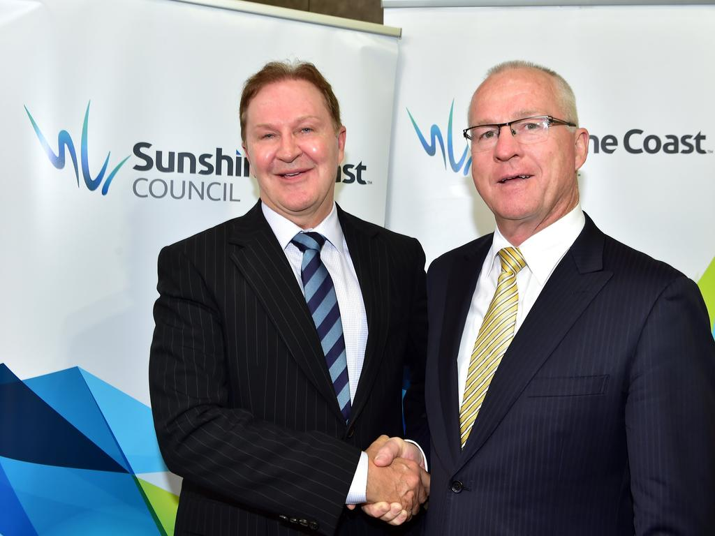 Sunshine Coast Council Mayor Mark Jamieson shaking hands with CEO, Michael Whittaker after his appointment to a five-year term in 2015. The council quietly extended Mr Whittaker's contract in February for an as yet revealed period. The Mayor has also yet to reveal if he will recontest the mayoralty.