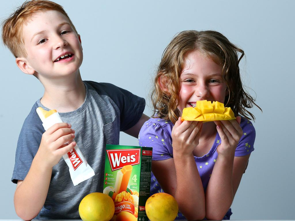Ben and Eliza Flanagan enjoying mangoes and Weis ice cream bars.