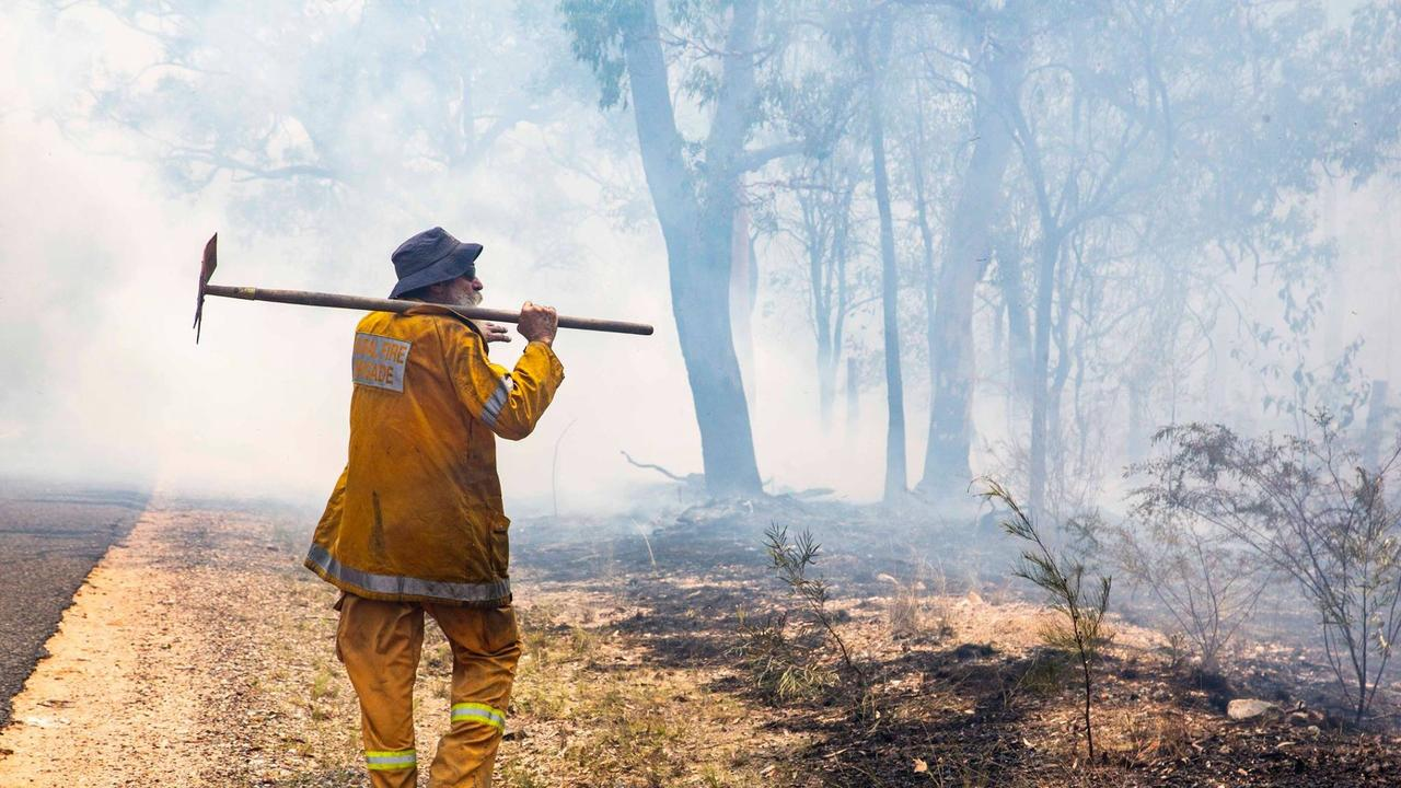 OUR HEROES: Queensland Fire and Emergency Service fireys and volunteers battling the blaze.