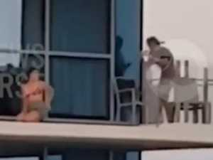 WATCH: Death-defying Schoolie filmed in high-rise stunt