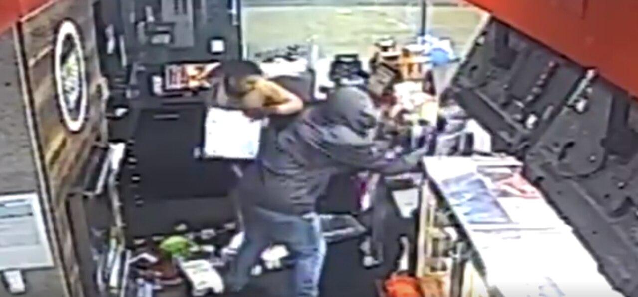The two men stole two tills full of cash before fleeing the scene.