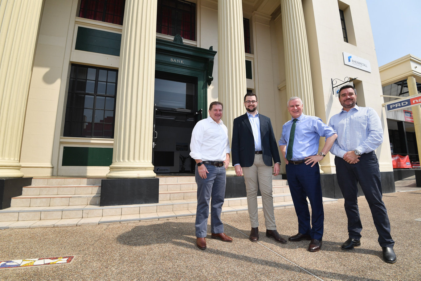 Rheinmetall office in Adelaide st, Maryborough -Member for Wide Bay Llew O'Brien, Rheinmetall director Jackson Nioa, Deputy PM Michael McCormack and project mgr. Jeff Crabtree outside the office. Photo: Alistair Brightman