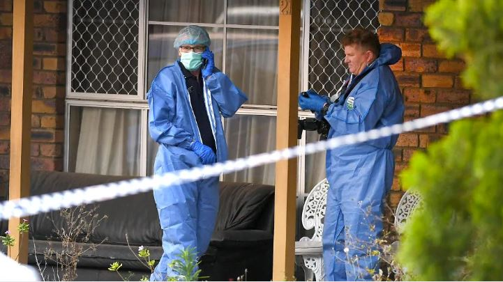 Forensic officers at the house where a brother and sister were found dead. Picture: AAP/John Gass