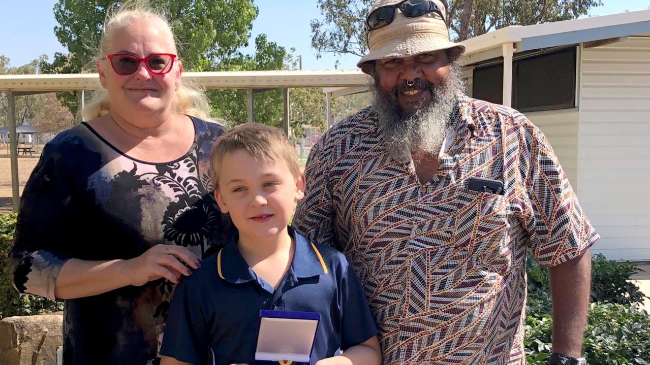 Jensen Needham with Clarke Creek State School principal Jen Worsley and Kevin McPherson