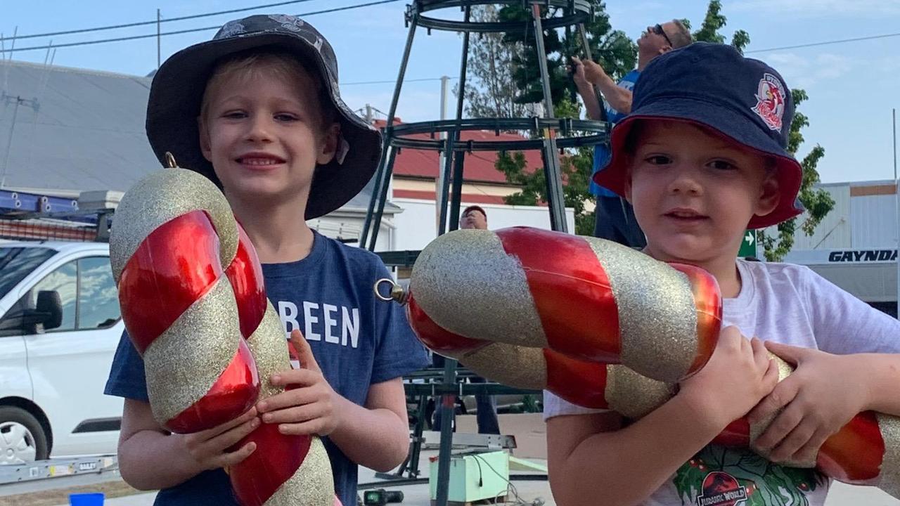 FEELING FESTIVE: Jensen Callanan and Emmett Willis help set up the 2019 Community Christmas Tree in Gayndah on Saturday. Photo: Contributed