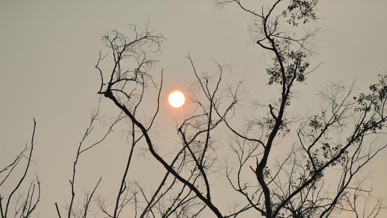 The sun shrouded in smoke, turning it an ominous red. Picture: Kevin Farmer
