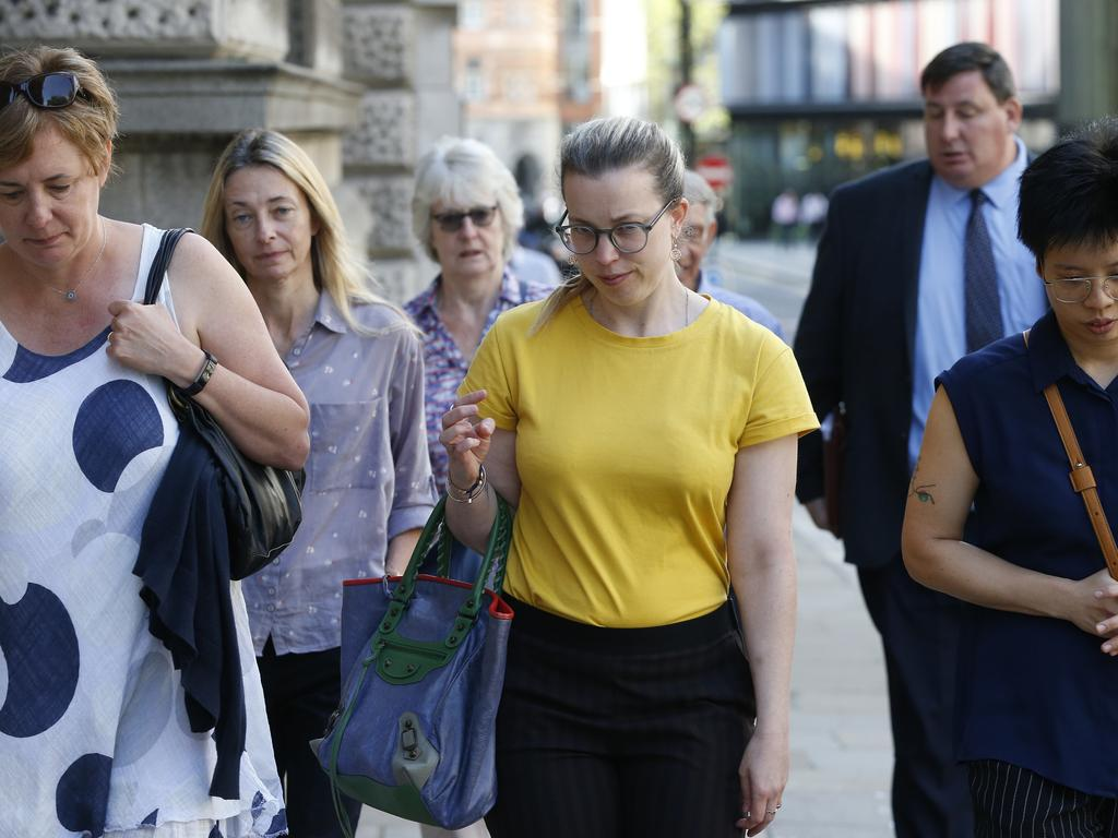 Amy Parsons' sister Eve (in yellow) leaving court with supporters on Tuesday. Picture: Hollie Adams/News Corp Australia