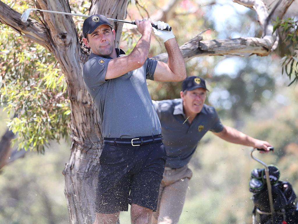 Melbourne coach Craig Bellamy keeps a close watch on Cameron Smith during President's Cup celebrity golf day. Picture: Michael Klein