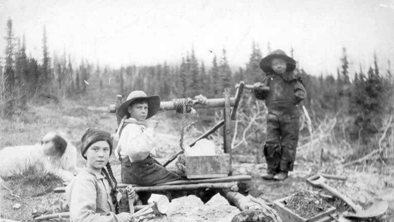A 120-year-old photo of three children in a gold mining area has sparked conspiracy theories due to one of the children's striking resemblance to teen climate activist Greta Thunberg. Picture: Eric A. Hegg