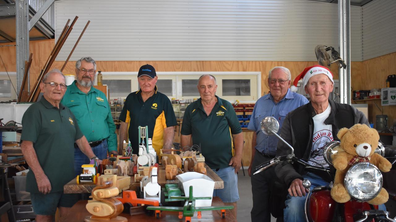 Men's Shed members, Mike Stuhmcke, Bill Vierveyzer, Neil Stephenson, Carin Thompson, Alec Waldron and organiser, John Finnigan preparing for the Maranoa Motorcyclists Toy Run.
