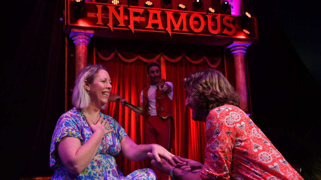 SURPRISE: Darren Gidney proposes to Hayley Waylett at the Infamous Circus in Maroochydore. Photo: John McCutcheon