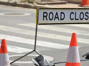Road closed after truck loses control