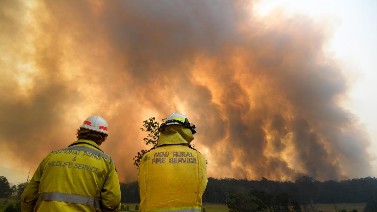 Smoke from a large bushfire near Nana Glen, on Tuesday, November 12. (AAP Image/Dan Peled)