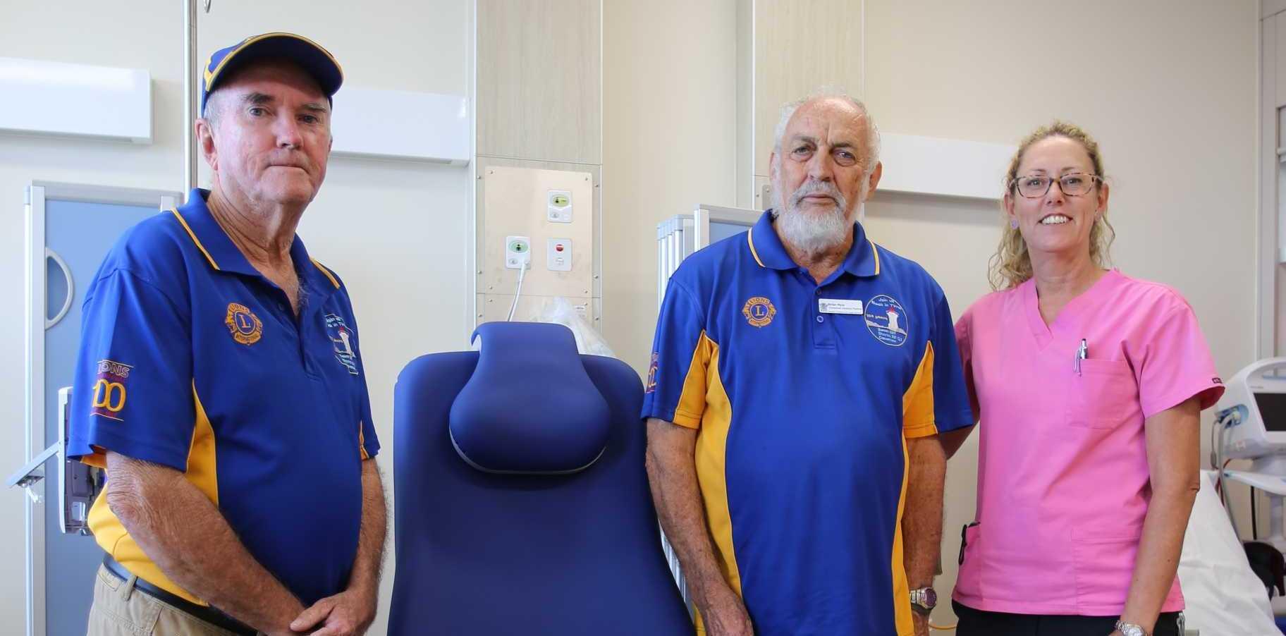 SIT DOWN: Bowen Lions Club member Peter Goodman, oncology nurse Jay Doig and Bowen Lions Club vice-president Brian Ryles.
