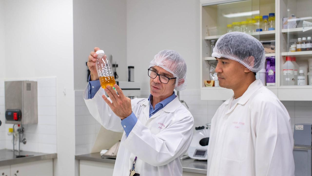 SCIENCE: Senior food scientist Andrew Forrest and senior technician Carl Paulo inspect a brew sample.