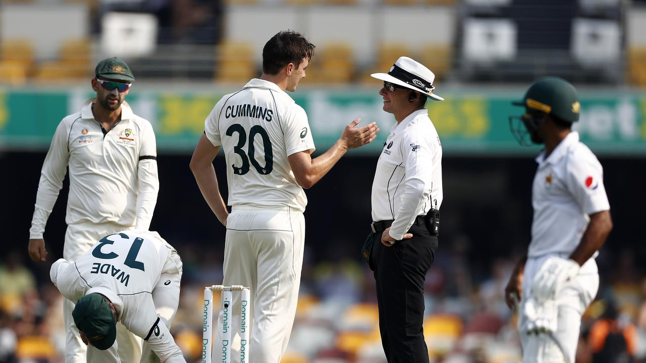 Pat Cummins speaks to umpire Richard Kettleborough as his wicket of Mohammad Rizwan is review. Picture: Getty