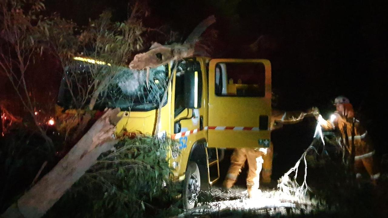 A group of dedicated volunteer firefighters are lucky to be alive after a tree collapsed onto their truck while they attended to a blaze northwest of Brisbane.