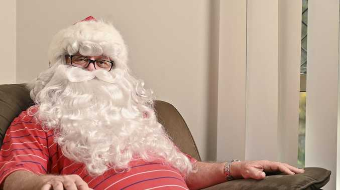 Professional Santa giving kids what he never had growing up
