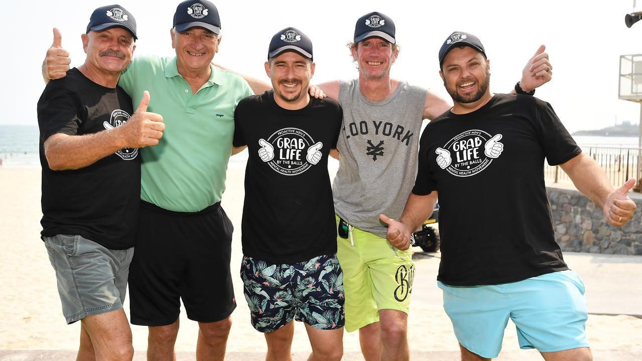 THUMBS UP: Grab Life by the Balls founder Sam Parker (centre) celebrates the proactive and positive men's health movement turning three with Howard OMeara, Richard Scott, Daryl Weldon and Ryan Tolley. Photo Patrick Woods.
