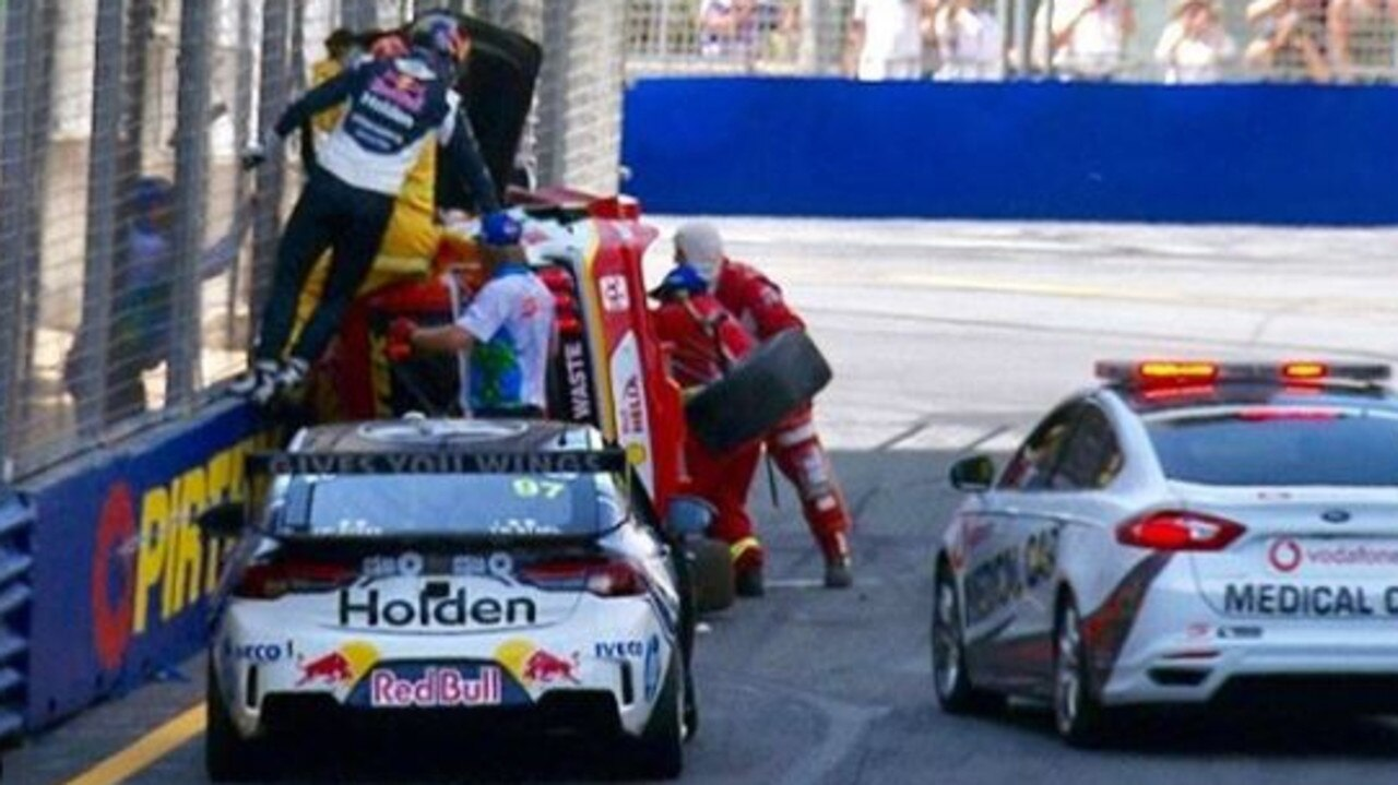 Shane van Gisbergen (fence in blue) rushed to help Scott McLaughlin after a crash at the V8 Supercars Vodafone Gold Coast 600. Picture: steinhouradam (Instagram)