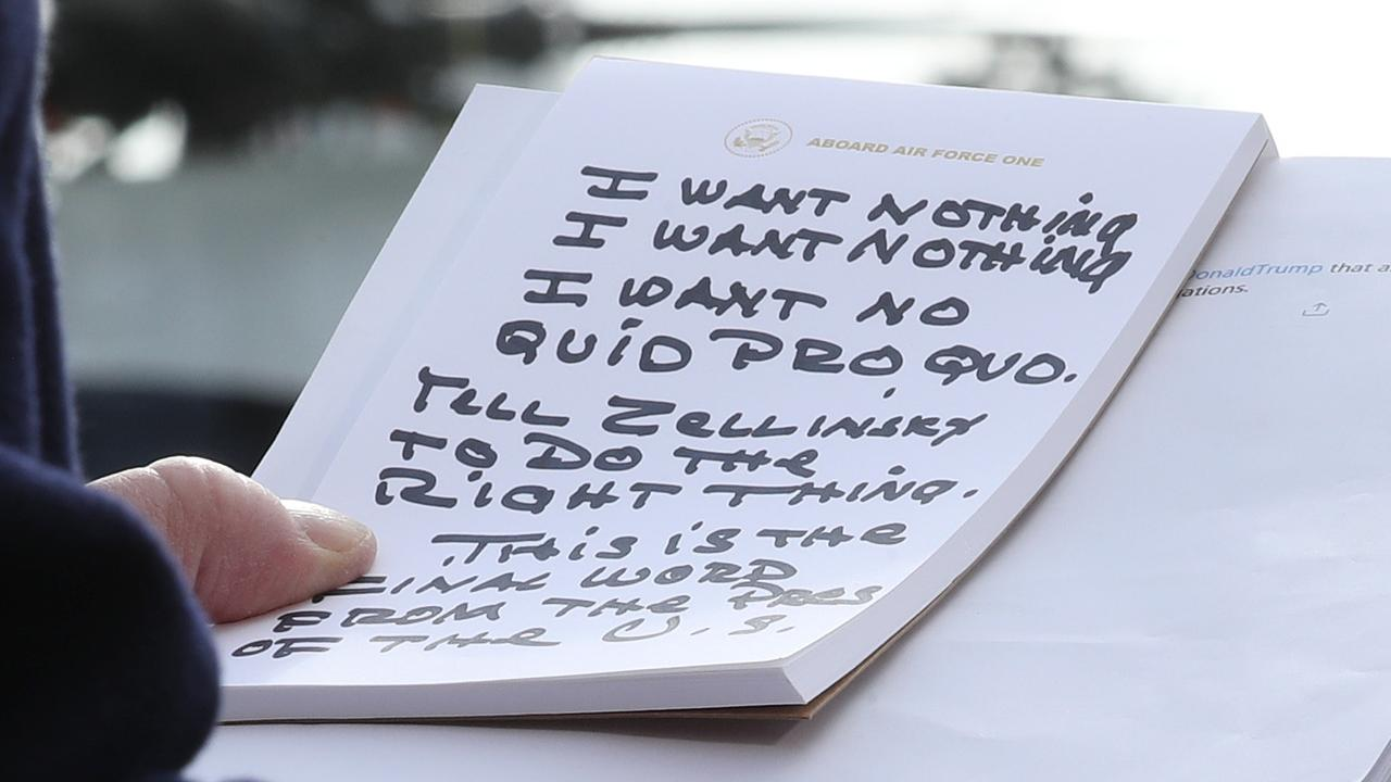 Donald Trump holds his notes while speaking to the media before departing from the White House.