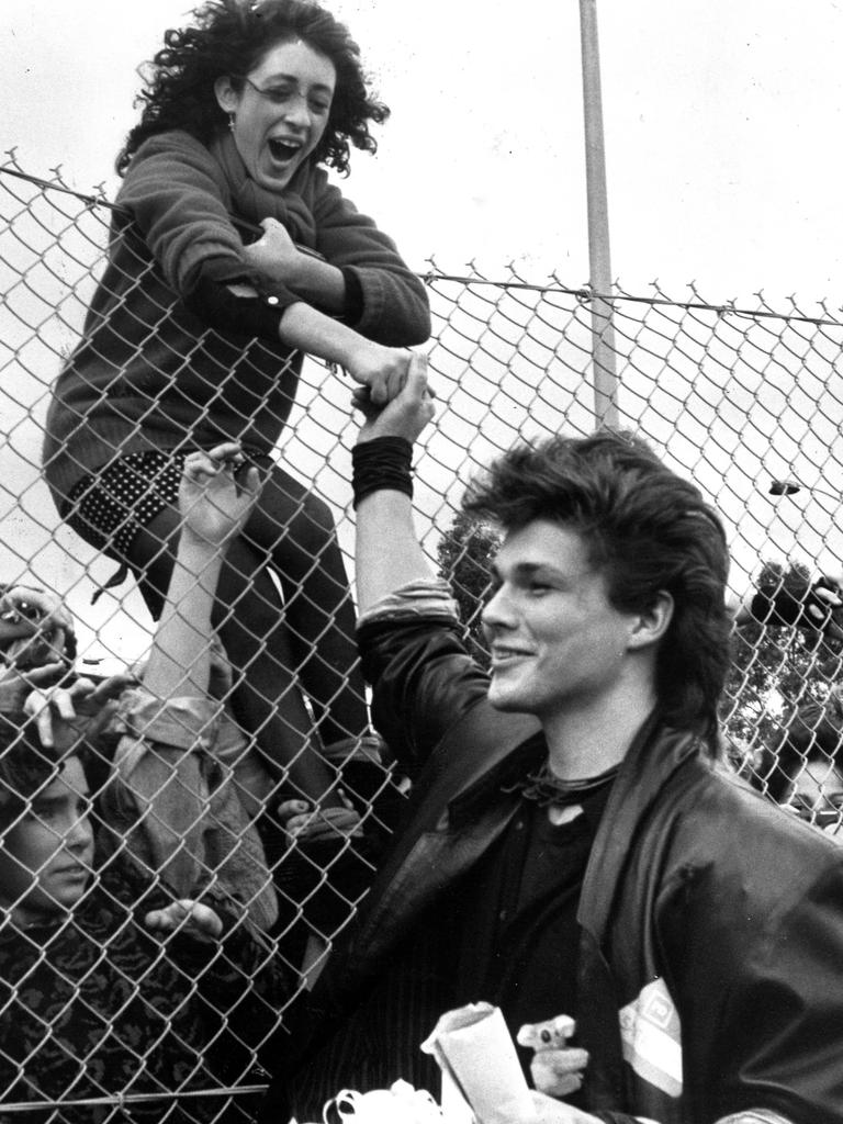 A-Ha lead singer Morten Harket shakes the hand of a fan at Tullamarine Airport in Melbourne, 1986.