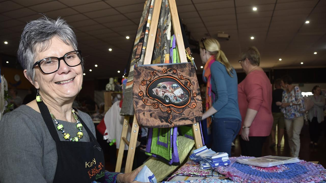 Creating rugs made by recycling fabrics, Kat Adams and the Handmade Expo Market at Harristown High School in July 2018.