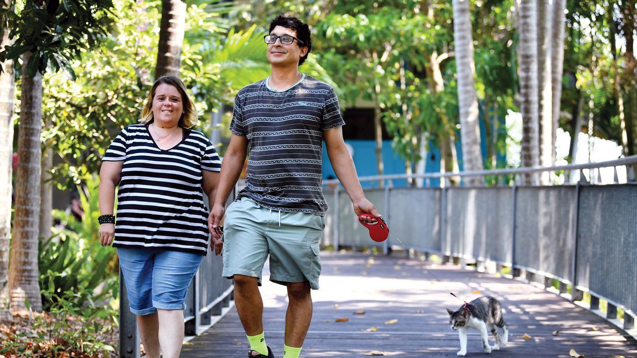 Natalie Weston and Nicolas Capone take their cat Ninja for a walk at the Mackay Regional Botanic Gardens.