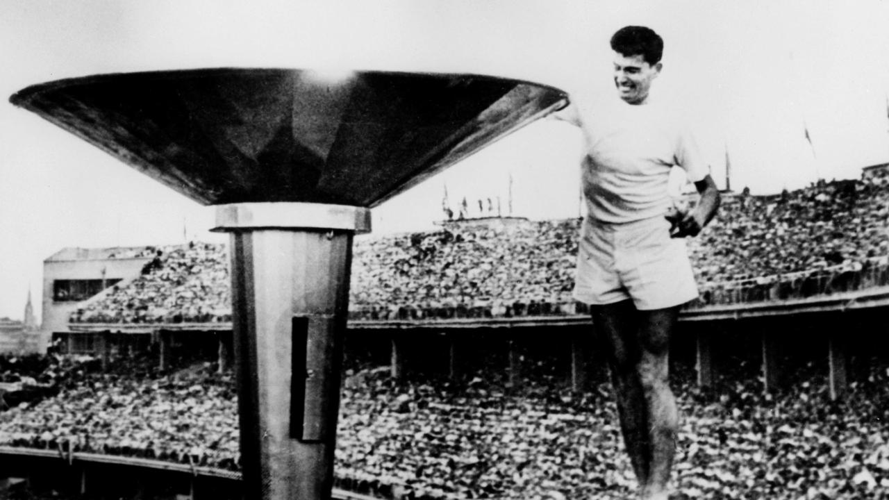 Ron Clarke lights the Olympic Flame at the Melbourne Olympic Games opening ceremony.