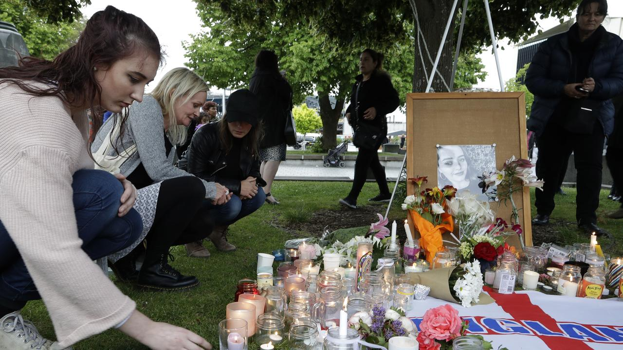People lay flowers and light candles during a vigil for the murdered British tourist Grace Millane at Cathedral Square in Christchurch, New Zealand, after her death last year.