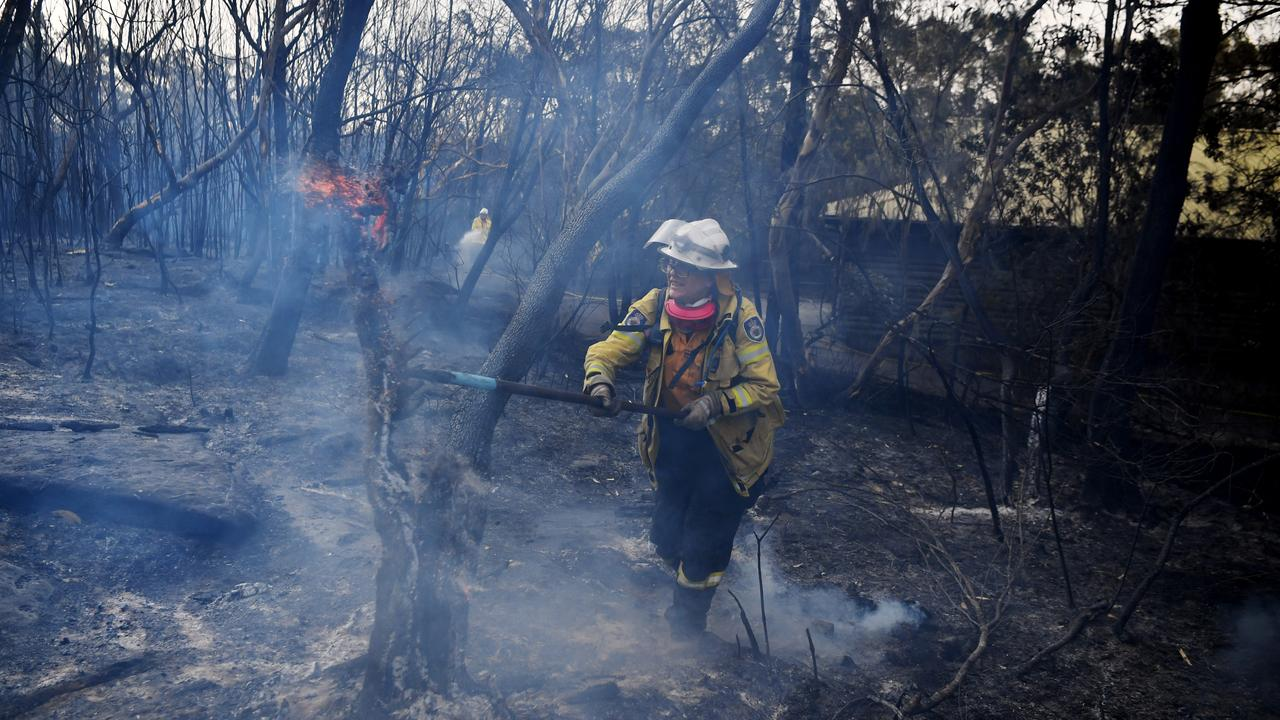 A NSW RFS firefighter mops up at South Turramurra on November 12, 2019 in Sydney, Australia. Picture: Getty