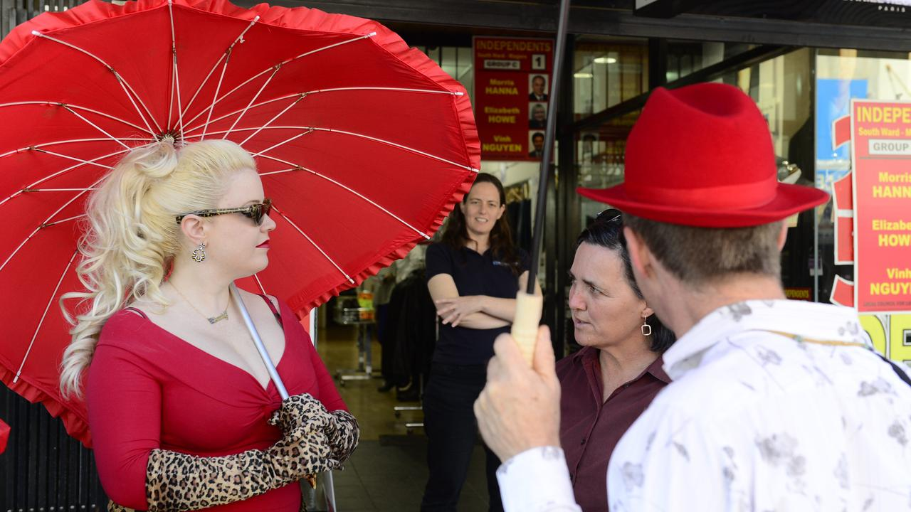 Sex workers sporting red umbrellas, a common symbol of sex worker rights.