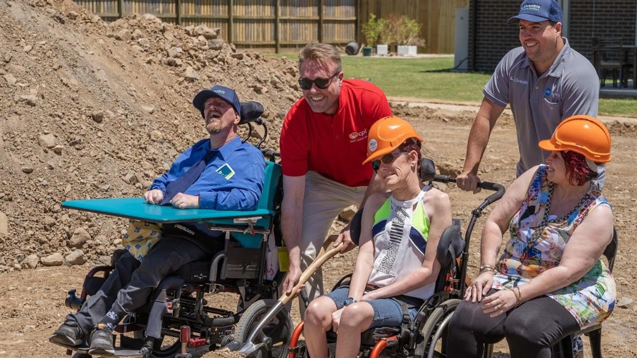 NEW START: Tim, Rhys Kennedy, Jesse Zielke, Helena Kidd and Karen celebrate the beginning of a custom built house for people with disabilities