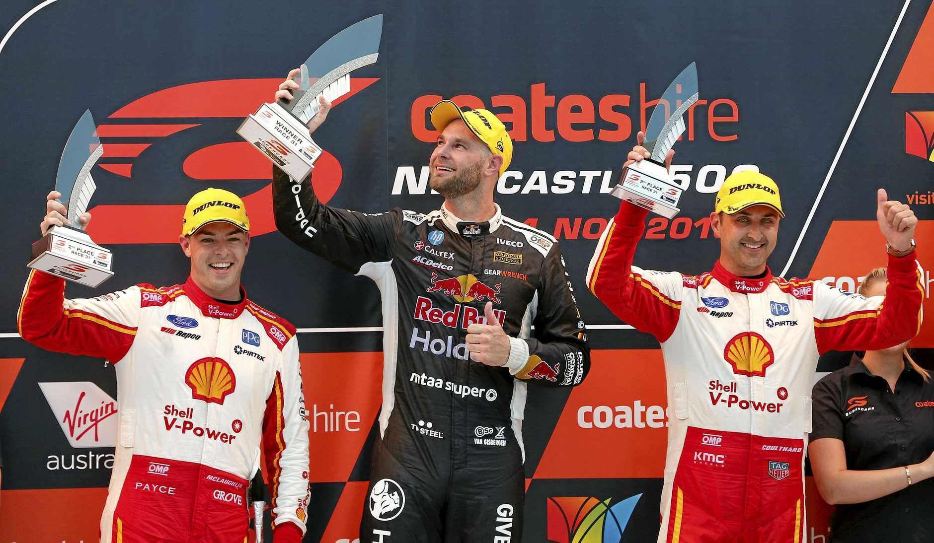 Runner-up Scott Mclaughlin, winner Shane van Gisbergen and third-placed Fabian Coulthard enjoy the moment on the podium at the Newcastle 500 on Saturday. Picture: Darren Pateman/AAP